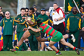 Baden Morey tackles  Peni Buakuka infront of the Pukekohe coaches. Counties Manukau Premier Club Rugby game between Pukekohe and Waiuku played at Colin Lawrie Fields, Pukekohe, on Saturday July 3rd 2010. Pukekohe won 31 - 12 after leading 15 - 9 at halftime.