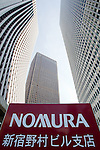 August 3, 2012 - Tokyo, Japan - The Shinjuku building of Nomura Holdings Inc. (right) is seen in downtown Tokyo. Japan regulators ordered Nomura Holdings Inc. to improve its internal security operations over the recent insider info trading scandal, after two of Nomura's top executives resigned to take responsibility for this incident. (Photo by Christopher Jue/AFLO)