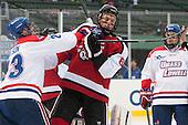 Scott Wilson (UML - 23), Mike Gunn (NU - 6) - The Northeastern University Huskies defeated the University of Massachusetts Lowell River Hawks 4-1 (EN) on Saturday, January 11, 2014, at Fenway Park in Boston, Massachusetts.