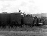 Lawrenceville PA: Location photography at the Atlantic Refining site at 5733 Butler Street. View of workman checking the oil level inside one of the storage tanks.<br /> This track of land has been involved in oil-related refining for over 100 years.  ARCO sold the property to SUNOCO which still operates a storage facility at 5733 Butler Street.