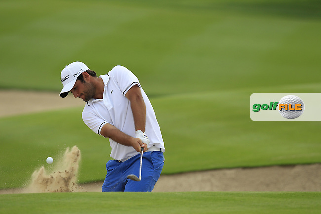 Alexander Levy (FRA) chips from a bunker at the 13th green during Sunday's Final Round of the Abu Dhabi HSBC Golf Championship 2015 held at the Abu Dhabi Golf Course, United Arab Emirates. 18th January 2015.<br /> Picture: Eoin Clarke www.golffile.ie