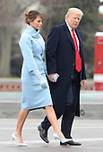 President Donald Trump and First Lady Melania Trump walk to say goodbye to Former President Barack Obama as he helicopters to Joint Base Andrews after the inauguration on January 20, 2017 in Washington, D.C.  Trump became the 45th President of the United States.       <br /> Credit: Kevin Dietsch / Pool via CNP