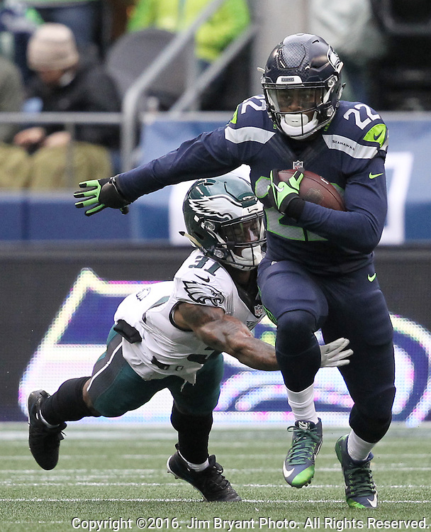Seattle Seahawks running back C.J. Prosise (22) breaks a tackle by Philadelphia Eagles cornerback Jalen Mills (31) while on his way to a 73-yard touchdown in the first quarter<br /> at CenturyLink Field in Seattle, Washington on November 20, 2016.  Seahawks beat the Eagles 26-15.  &copy;2016. Jim Bryant Photo. All Rights Reserved.