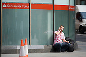 Man using a mobile phone in the City of London.