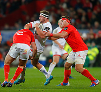 9th November 2019; Thomond Park, Limerick, Munster, Ireland; Guinness Pro 14 Rugby, Munster versus Ulster; Rob Herring (c) of Ulster is tackled by Niall Scannell and CJ Stander of Munster - Editorial Use