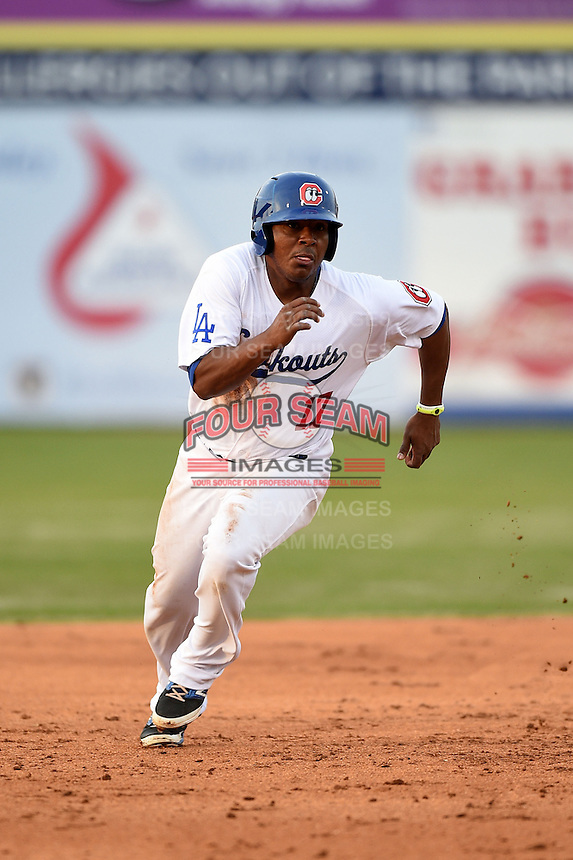 Chattanooga Lookouts third baseman Daniel Mayora (17) runs the bases during a game against the Birmingham Barons on April 24, 2014 at AT&T Field in Chattanooga, Tennessee.  Chattanooga defeated Birmingham 5-4.  (Mike Janes/Four Seam Images)