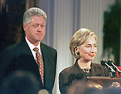 "First lady Hillary Rodham Clinton introduces the ""Millennium Evening Lecture Series"" from The East Room, The White House as her husband, United States President Bill Clinton, awaits his turn to speak on 18 September, 1998.<br /> Credit: Ron Sachs / CNP"