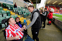 Lincoln City's Aaron Lewis with a fan prior to the game<br /> <br /> Photographer Chris Vaughan/CameraSport<br /> <br /> The EFL Sky Bet League One - Lincoln City v Sunderland - Saturday 5th October 2019 - Sincil Bank - Lincoln<br /> <br /> World Copyright © 2019 CameraSport. All rights reserved. 43 Linden Ave. Countesthorpe. Leicester. England. LE8 5PG - Tel: +44 (0) 116 277 4147 - admin@camerasport.com - www.camerasport.com