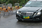 A VIP official Brazilian government car passes a line of shields and truncheons of army shock troops during the United Nations Conference on Sustainable Development (Rio+20), Rio de Janeiro, Brazil, 20th June 2012. Photo © Sue Cunningham.