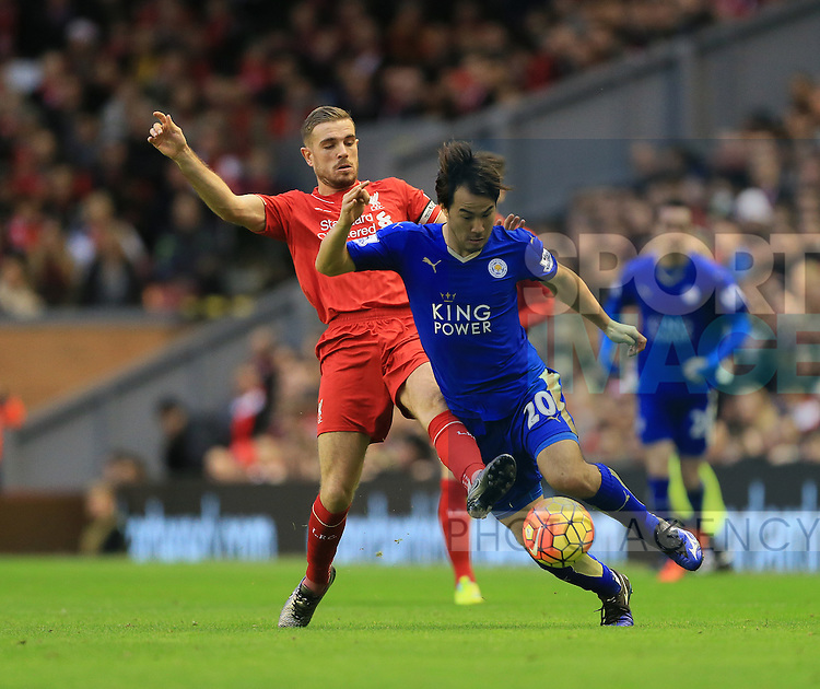 Liverpool's Jordan Henderson tussles with Leicester's Shinji Okazaski<br /> <br /> Barclays Premier League- Liverpool vs Leicester City - Anfield - England - 26th December 2015 - Picture David Klein/Sportimage