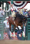 Jace Angus competes in the saddle bronc riding event at the Reno Rodeo in Reno, Nev., on Friday, June 20, 2014.<br />