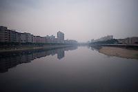 Urban Development on a river in Dongguan, China.  © LAN