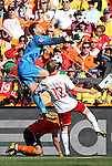 14 JUN 2010:  Goalie Maarten Stekelenburg (NED)(1) pulls the ball out of the air as Thomas Kahlenberg (DEN)(12) comes onto the ball.  The Netherlands National Team defeated the Denmark National Team 2-0 at Soccer City Stadium in Johannesburg, South Africa in a 2010 FIFA World Cup Group E match.
