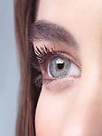 Closeup of a young woman beautiful gray eye