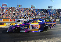 Jul, 8, 2011; Joliet, IL, USA: NHRA funny car driver Ron Capps (near lane) alongside Matt Hagan during qualifying for the Route 66 Nationals at Route 66 Raceway. Mandatory Credit: Mark J. Rebilas-