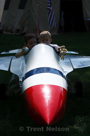 Salt Lake City - Kurtis (left) and Annabelle Bates sit in the cockpit of a model F-16 fighter during Air Force Week festivities at Pioneer Park Tuesday June 2, 2009.