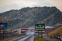 Jul 21, 2018; Morrison, CO, USA; Overall view of Bandimere Speedway as NHRA top fuel drivers Antron Brown (left) and Doug Kalitta do burnouts during qualifying for the Mile High Nationals. Mandatory Credit: Mark J. Rebilas-USA TODAY Sports