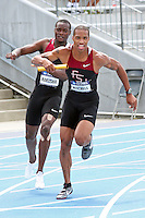 Florida State junior Maurice Mitchell runs with the baton after receiving it from teammate Ngonidzashe Makusha in the 4x100 meter relay finals Saturday at the 2011 NCAA Division I Outdoor Track and Field Championships in Des Moines Iowa. Mitchell, the Raytown South graduate, helped the Seminoles win the race in 38.77 seconds.