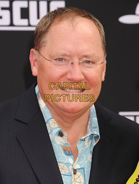 HOLLYWOOD, CA- JULY 15: Executive producer John Lasseter arrives at the Los Angeles premiere of Disney's 'Planes: Fire &amp; Rescue' at the El Capitan Theatre on July 15, 2014 in Hollywood, California.<br /> CAP/ROT/TM<br /> &copy;Tony Michaels/Roth Stock/Capital Pictures