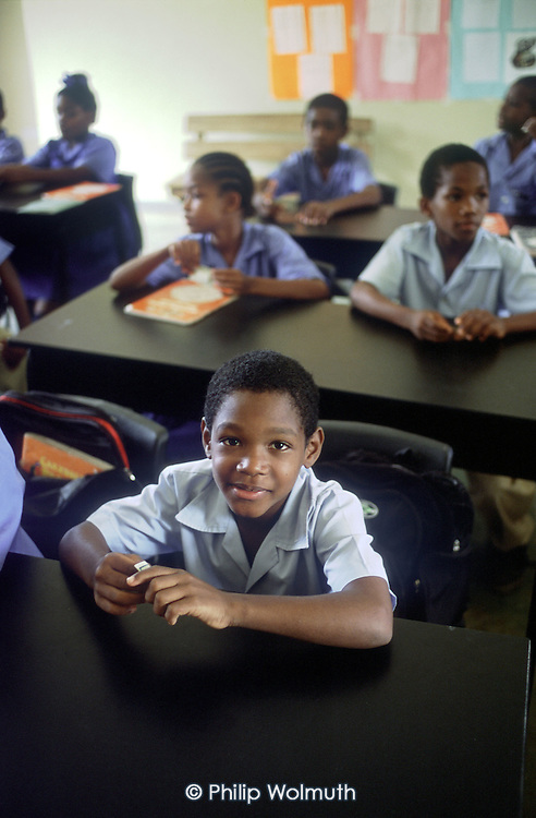 "Castle Bruce Primary School received EC$10,000 of the ""social premium"" paid to the Dominica Fairtrade Organisation. The money generated by Fairtrade banana exports to the UK funded the purchase of desks and chairs, and made possible the end of a half-day shift system, allowing pupils to attend for the full school day."