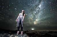 Sarah poses during a model shoot out at my favorite dark sky locations at Cape Palliser in New Zealand. The stars and Milky Way were an amazing background to shoot Sarah against. This photo was all done in one exposure, so no compositing at all.