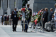 Washington, DC - June 6, 2014: In remembrance of the 70th anniversary of the D-Day invasion, WWII veteran Herman Zeitchik (left) participates in a wreath laying ceremony at the National World War II Memorial  in the District of Columbia. Zeitchik was a member of the U.S. Army 4th Infantry Division during the D-Day invasion of Normandy. (Photo by Don Baxter/Media Images International)