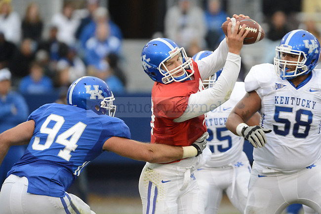 QB Jacob Russell is sacked during the University of Kentucky spring football scrimmage at Commonwealth Stadium in Lexington, Ky., on 4/21/12.  Photo by Mike Weaver | Staff