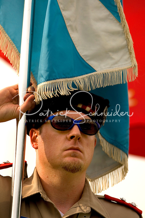 A man presents the colors during the 52nd Annual Grandfather Mountain Highland Games in Linville, NC.