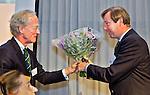 SOESTDUINEN - ALV (Algemene Ledenvergadering voorjaar) van de NGF. Frans van Oosten Slingeland (rechts) neemt afscheid van het bestuur van de NGF als penningmeester. links NGF president Ronald Pfeiffer. COPYRIGHT KOEN SUYK