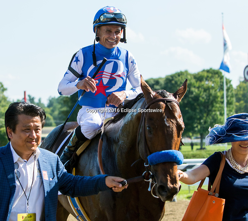 SARATOGA SPRINGS - AUGUST 27: Mike Smith, aboard Drefong #13, smiles as he is led to the winner's circle after winning the Ketel One King's Bishop Stakes on Travers Stakes Day at Saratoga Race Course on August 27, 2016 in Saratoga Springs, New York. (Photo by Sue Kawczynski/Eclipse Sportswire/Getty Images)