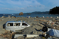 A car buried in the sand at  Minamisanriku, Myiagi, Japan.The fishing port of Minamisanriku, Miyagi, Japan where the popultion was reduced from 18,000 to about 8,000 when 10,0000 where washed out to sea.<br /> <br /> Photo by Richard Jones/ Sinopix