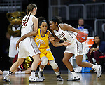 SIOUX FALLS, SD: MARCH 6: Danielle Lawrence #14 of IUPUI drives past South Dakota State defender Alexis Alexander #1 during the Summit League Basketball Championship on March 6, 2017 at the Denny Sanford Premier Center in Sioux Falls, SD. At left is Jenna Gunn #32 of IUPUI.  (Photo by Dick Carlson/Inertia)