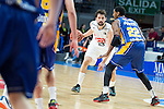 Real Madrid's Sergio Llull and UCAM Murcia's Kelati during the first match of the playoff at Barclaycard Center in Madrid. May 27, 2016. (ALTERPHOTOS/BorjaB.Hojas)