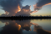 Pará State, Brazil. Xingu River. Dark clouds gather menacingly at Sunset.