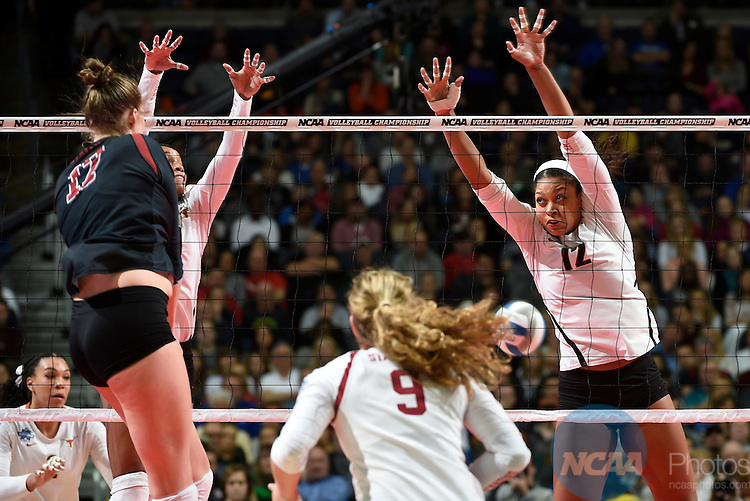 COLUMBUS, OH - DECEMBER 17:  Morgan Johnson (12) of the University of Texas tries to make a block against Stanford University during the Division I Women's Volleyball Championship held at Nationwide Arena on December 17, 2016 in Columbus, Ohio.  Stanford defeated Texas 3-1 to win the national title. (Photo by Jamie Schwaberow/NCAA Photos via Getty Images)