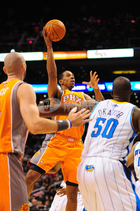Dec. 26, 2011; Phoenix, AZ, USA; Phoenix Suns forward/center Channing Frye takes a shot during the game against the New Orleans Hornets at the US Airways Center. The Hornets defeated the Suns 85-84. Mandatory Credit: Mark J. Rebilas-USA TODAY Sports