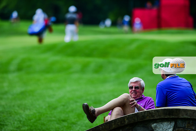 An avid golf fan sits on a walking bridge as golfers approach the 11th green during round 2 of the 2016 Quicken Loans National, Congressional Country Club, Bethesda, Maryland, USA. 6/24/2016.<br /> Picture: Golffile | Ken Murray<br /> <br /> <br /> All photo usage must carry mandatory copyright credit (&copy; Golffile | Ken Murray)