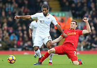 Wayne Routledge of Swansea City is tackled by James Milner (vice-captain) of Liverpool during the Premier League match between Liverpool and Swansea City at Anfield, Liverpool, Merseyside, England, UK. Saturday 21 January 2017
