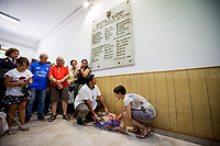Laying flowers at the &quot;Reparto Scorte&quot; memorial stone.<br />