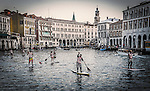 Stand up paddlers on the Grand Canal in Cannaregio, Venice, Italy