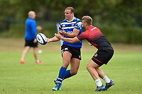 Jamie Roberts of Bath Rugby passes the ball against the visiting Dragons team. Bath Rugby pre-season training on August 8, 2018 at Farleigh House in Bath, England. Photo by: Patrick Khachfe / Onside Images