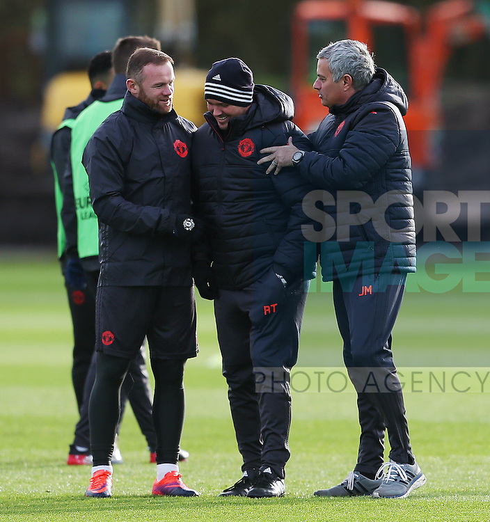 Manchester United manager Jose Mourinho and Wayne Rooney force club coach Rod Thornley to pose for photographs during the UEFA Europa League training session at the AON Training Complex, Manchester. Picture date: November 23rd 2016. Pic Matt McNulty/Sportimage