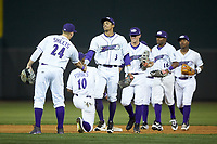 Joel Booker (3) of the Winston-Salem Dash shakes hands with teammate Gavin Sheets (24) following their win over the Buies Creek Astros at BB&T Ballpark on May 5, 2018 in Winston-Salem, North Carolina. The Dash defeated the Astros 6-2. (Brian Westerholt/Four Seam Images)