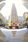 Rockefeller Plaza with GE Building, plaque about supreme worth of the Individual, and statue of Prometheus, Manahttan, NYC, USA. NOTE: 180 degree fish eye view. EDITORIAL USE ONLY