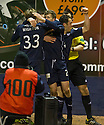 Dundee's Jim McAlister (20) is congratulated after the second goal.