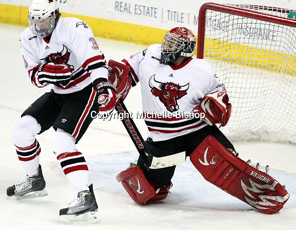 UNO goalie John Faulkner takes a puck to the shoulder during the first period. Faulkner finished with 33 saves to earn a school-record and NCAA-leading sixth shutout. UNO beat St. Cloud State 3-0 Friday night at Qwest Center Omaha.  (Photo by Michelle Bishop)