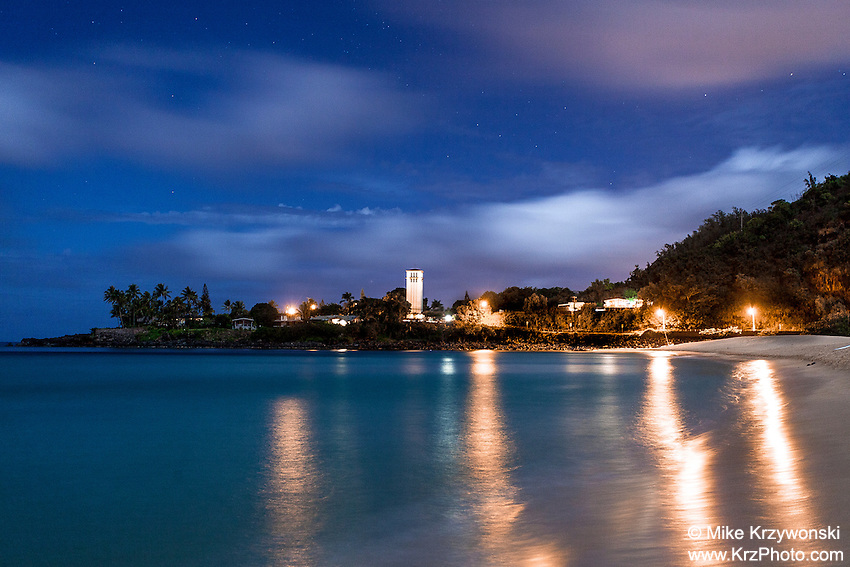 Waimea Bay at night w/ lights reflecting off the water, North Shore, Oahu, Hawaii
