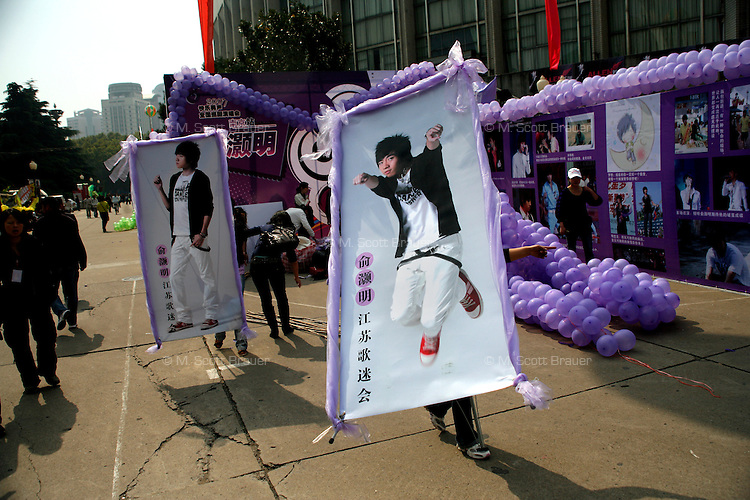 Girls set up a display in support of their favorite contestant in a city-wide singing competition in Nanjing, China.