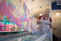 """Andrea Jones of Rogers reacts as she reveals a scarf she dyed using a water marbling technique, Sunday, January 12, 2020 during a water marbling class at Art & Soul Studios NWA in Rogers. Check out nwaonline.com/200113Daily/ for today's photo gallery.<br /> (NWA Democrat-Gazette/Charlie Kaijo)<br /> <br /> Marie Haley, artist and owner of Art & Soul Studios, lead a class to show art enthusiasts an innovative approach to dying fabrics. The water marbling technique is from the 15th century. Artists drop paints into a bath of seaweed solution that rises to the top. Afterwards, they use tools to create designs with the paint before dipping their fabric into the bath. <br /> <br /> Visitors who tried the art style shared their experience of the process saying, """"This is satisfying because you can't mess up. It doesn't take that long. You get instant gratification."""" And """"What it turns out to be might not be what you expected."""""""