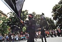 - Genova G8 2001, manifestazioni contro il summit. I Black Bloc sfilano in piazza Manin...- Genoa G8 2001, Demonstration against the summit. The Black Bloc parades in front of the demonstrants in Manin Square.